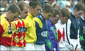 A minute's silence is conducted at Newmarket, Cambridgeshire