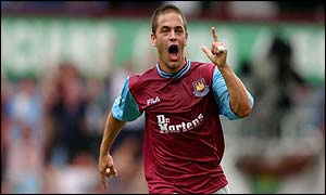 Joe Cole celebrates his opening strike