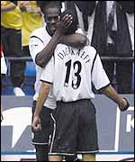 Michael Ricketts congratulates Youri Djorkaeff after he put Bolton in the lead