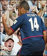 Thierry Henry is delighted with his goal