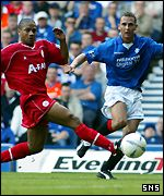 Peter Lovenkrands tries to get past Eric Deloumeaux