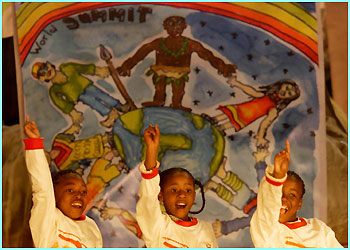 Children sing during the welcoming ceremony of the Summit at Ubuntu village, Johannesburg