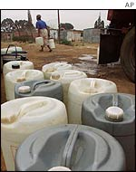 Residents of a Johannesburg township pile up water supplies