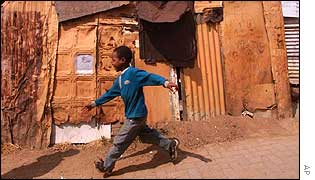 Young boy plays among shacks in Alexandra, not far from the summit venue