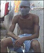 A Yardie in Jamaica displays his gun