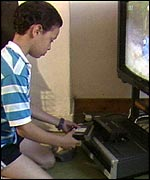 Child using VHS video recorder