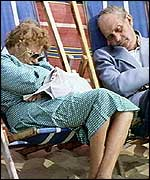 Couple asleep on deckchairs