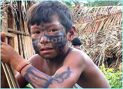 Now he has his face paint on, Tamata'i  is ready to go hunting for food with his father