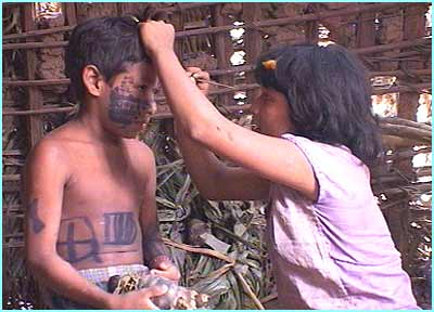 Before Tamata'i goes hunting in the jungle his face is painted to make him feel brave