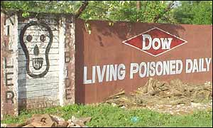Graffiti on Union Carbide factory wall, now owned by Dow Chemical