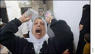 A Palestinian woman weeps for the victims
