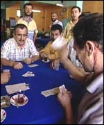 Card players in coffee house