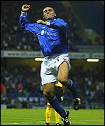 Tommy Miller celebrates after opening the floodgates at Portman Road