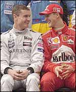 David Coulthard and Michael Schumacher share a joke