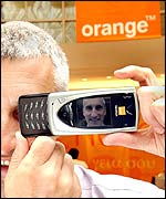 David Taylor, commercial director of Orange UK, with a mobile phone camera