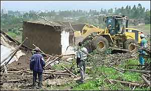 Bulldozers destroy homes