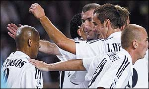 Roberto Carlos (left) is congratulated by Zinedine Zidane and Raul among others