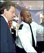 Tony Blair with a police officer