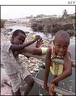 Senegalese children play near a polluted canal
