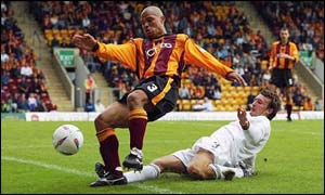 Bradford players like Andy Myers (left) will be paid for the first time in nearly four months