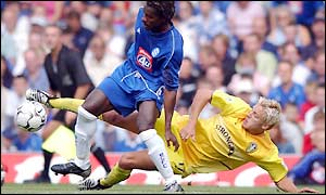 Alan Smith gets in a strong challenge for Leeds