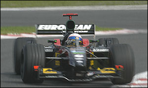 Anthony Davidson guides his Minardi around Spa