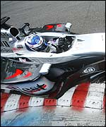Kimi Raikkonen hurls his McLaren around Spa