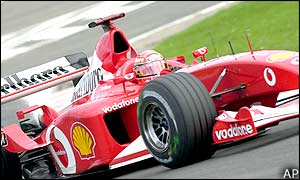 World champion Michael Schumacher improves his pole position time to 1:43.726 to make sure his Ferrari starts on the front row of the grid