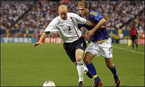 England's Danny Mills holds off Sweden's Teddy Lucic