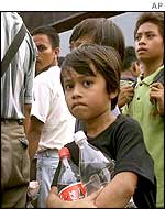 A Filipino child waits for deportation