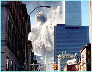 The south tower collapses first in a shower of ash and dust