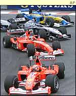 Michael Schumacher leads Rubens Barrichello, Kimi Raikkonen, Jarno Trulli and Juan Pablo Montoya at the start of the Belgian Grand Prix