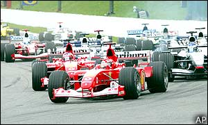The race gets off to a clean start with pole-sitter Michael Schumacher blasting his way off the grid, maintaining first place