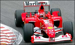 Schumacher extends his lead from Ferrari team mate Rubens Barrichello as he runs away with the Begian GP
