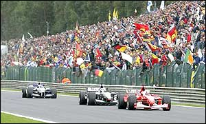 Rubens Barrichello leads from KImi Raikkonen and Juan Pablo Montoya as the trio fight for second place
