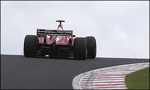 Michael Schumacher crests the brow at Raidillon during the 2002 Belgian Grand Prix