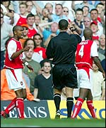Referee Andy D'Urso hands Patrick Vieira a red card