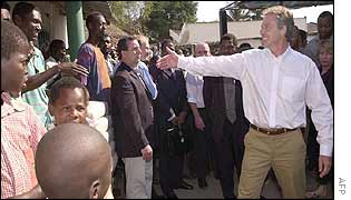 Tony Blair meets local people in a Mozambique village