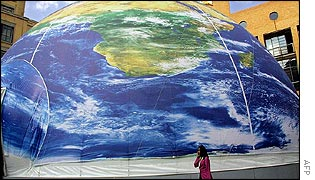 Delegate passes giant model of the world in South Africa