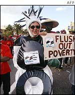 Protester dressed as a toilet holds a sign calling for delegates to