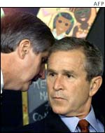 US President George W. Bush has his early morning school reading event interupted by his Chief of Staff Andrew Card