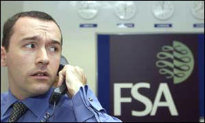 Financial Services Authority worker on phone in emergency HQ