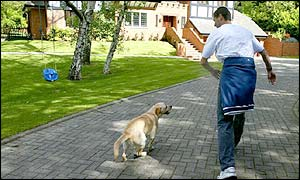 Roy Keane walks his dog after his ignomonious return from the World Cup