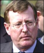 First minister David Trimble: Threatening to collapse power sharing executive