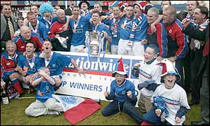 Linfield players celebrate after winning last season's Irish Cup