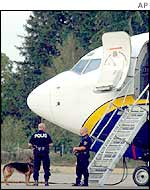Swedish police by the evacuated Ryanair plane