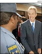 Tony Blair chats with police