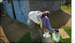 African woman washing clothes in a bucket