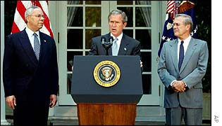 Secretary of State Colin Powell, left, President George W Bush and Defense Secretary Donald Rumsfeld