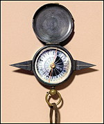 A brass-cased floating compass